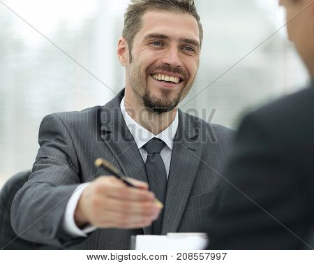closeup.a successful businessman, signing a lucrative contract