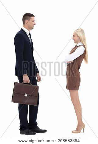 photo in full growth. friendly businessman and a young woman assistant