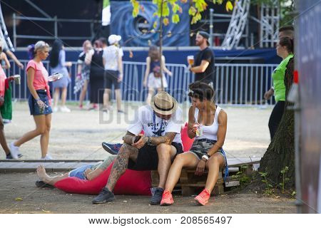 Cluj-Napoca, Romania - August 4, 2017:  People have having fun and relaxing at Untold festival, one of the biggest music festivals in Eastern Europe