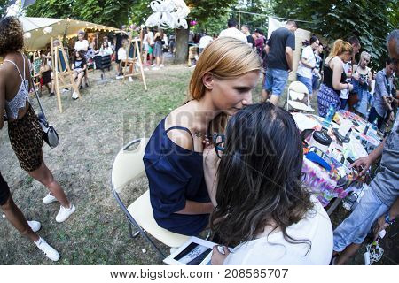 Cluj-Napoca, Romania - August 4, 2017:  People having fun at beauty and fashion corner at Untold festival, one of the biggest music festivals in Eastern Europe