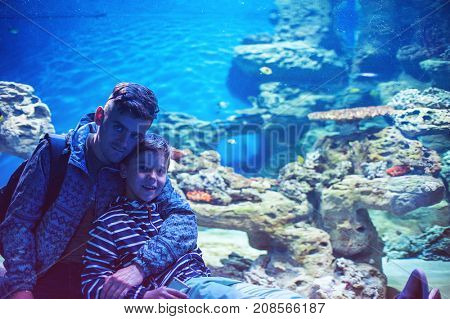 Photo of man with son in the oceanarium