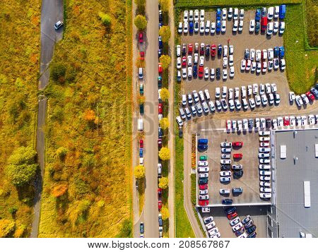 Aerial view of parking lot with cars. Industrial background on transportation theme.