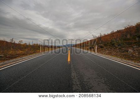 Norwegian road in north on an autumn day.