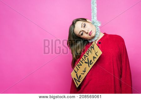 A beautiful overwhelmed woman in red pajamas with a sign