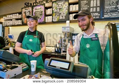 SAINT PETERSBURG, RUSSIA - CIRCA OCTOBER, 2017: indoor portrait of staff at a Starbucks coffee shop in Saint Petersburg. Starbucks Corporation is an American coffee company and coffeehouse chain.