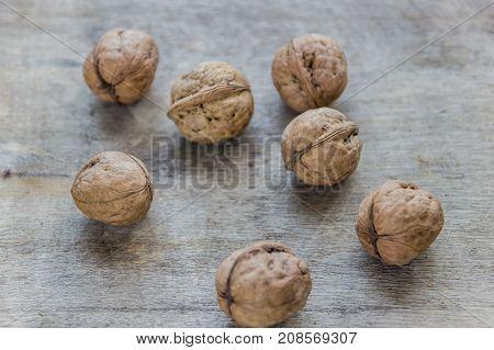Walnuts On Wooden Table. Whole Fresh Walnuts