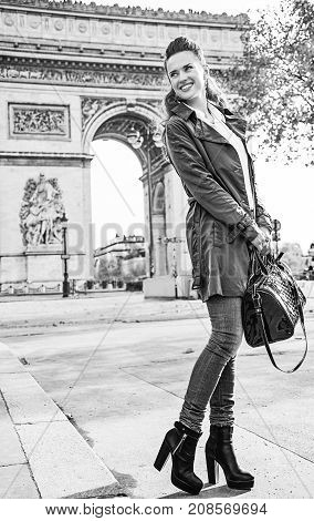 Smiling Young Trendy Woman In Paris, France Looking Aside