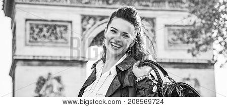 Smiling Elegant Woman Near Arc De Triomphe In Paris, France