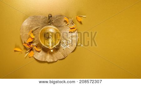 A beautiful golden Diwali Lamp and flower background with clear space for headline and text.