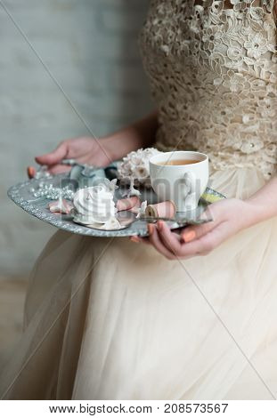 Cropped Image Of Woman Hands Holding A Tray With Coffee