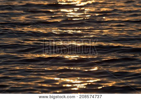 seamless texture warm color shining sunset water surface .