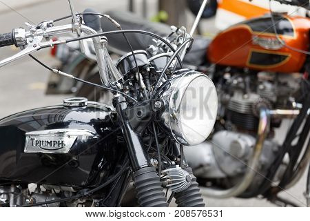 STOCKHOLM SWEDEN - SEPT 02 2017: Closeup of shiny black retro motorcycle at the Mods vs Rockers event at the Saint Eriks bridge Stockholm Sweden September 02 2017