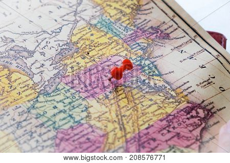 Map Of Usa With A Red Pushpin Stuck. Close-up Of Several Color Pushpin On A Geographic Map. The Choi