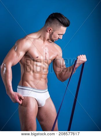 Fitness Belt, Man Sports With Belt, Sports Equipment, Tools For Training In Gym. Handsome Young Man