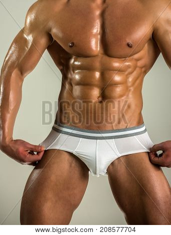 Men's Fashion Underwear. Strong Naked Man Shows His Panties On The Body. Athlete With Muscles Advert
