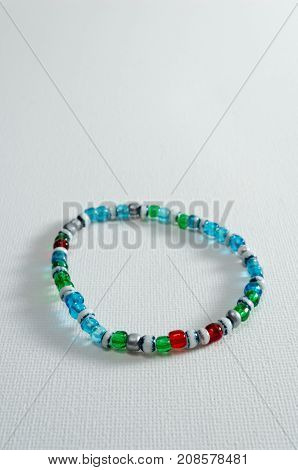 A Studio Photograph of a Multicoloured Transparent Bead Bracelet