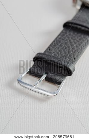 A Studio Photograph of a Black Leather Watch Strap