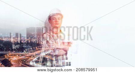Builder man against cityscape