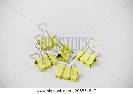 A Studio Photograph of a Group of Yellow Bulldog Clips
