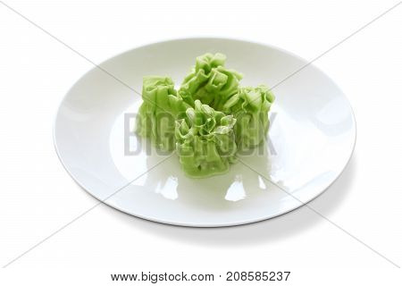 green skin wonton on a white plate dimsum