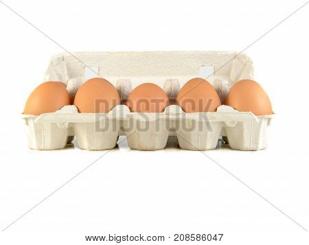 Close up of brown eggs in a egg tray. Chicken eggs. Fresh eggs on a white background