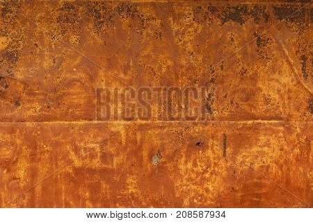 Metal corroded texture. Rusty metal background from an old industrial door. Dark worn rusty metal texture background. Texture of a rusty old surface