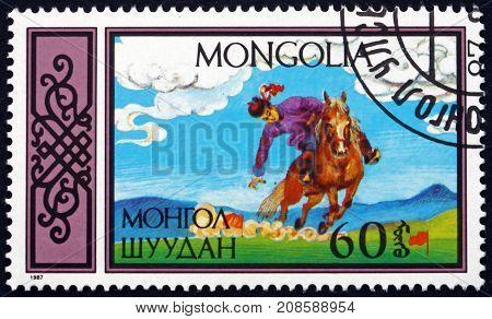 MONGOLIA - CIRCA 1987: a stamp printed in Mongolia shows Retrieving Flags Traditional Equestrian sports circa 1987