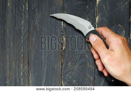 A Man Holds A Knife In His Right Hand. Knife For Attack.