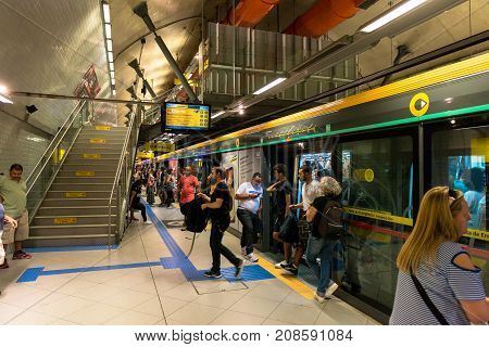 SAO PAULO BRAZIL - OCTOBER 12 2017: Horizontal picture of people leaving the train at the metro station Paulista yellow line located in the city of Sao Paulo Brazil.