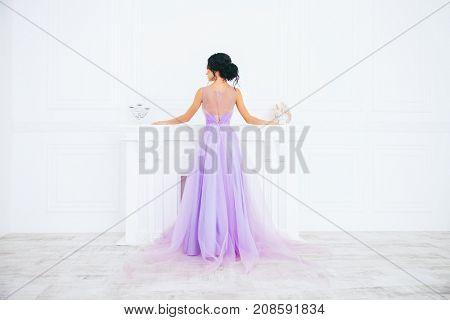 Beautiful bride in a luxurious apartments. Wedding fashion.