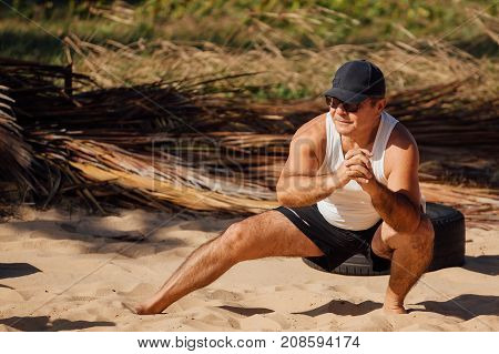 Cabedelo, Paraiba, Brazil - October 7, 2017 - Man on the beach in functional circuit training