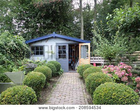 Little gray wooden garden barn