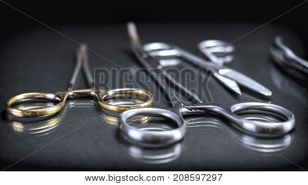 Several scissors operating theater aligned, conceptual image