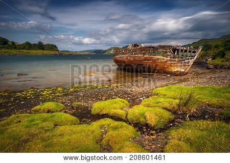 Abandoned boat in Ardvasar harbour Isle of Skye Scotland