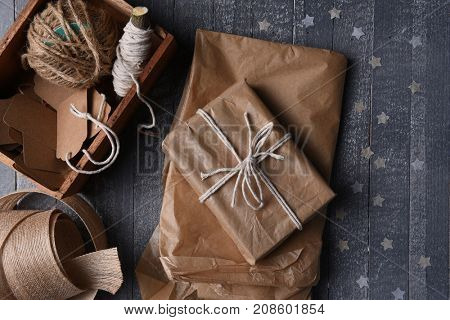 High angle shot of plain brown paper gift wrapping supplies with paper stars.