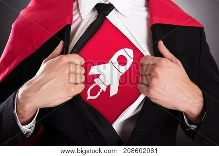 Close-up Of Businessman In Cape Opening Coat In Superhero Style