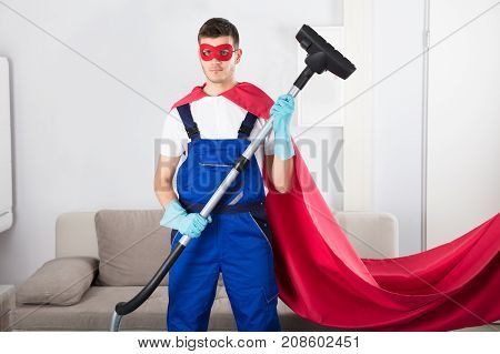 Superhero Janitor With Vacuum Cleaner In Living Room