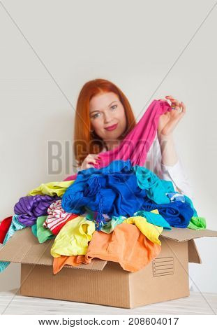 A Woman Is Busy With The Clutter In Her Wardrobe.