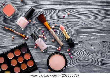 Eye shadows and rouges beige, nude colors on grey background top view.