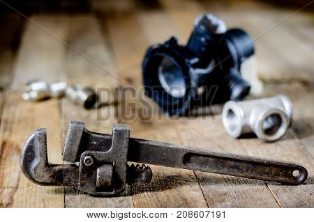 Hydraulics, Tools For Plumber On Wooden Table. Workshop, Table And Tools - Adjustable Spanner, Conne