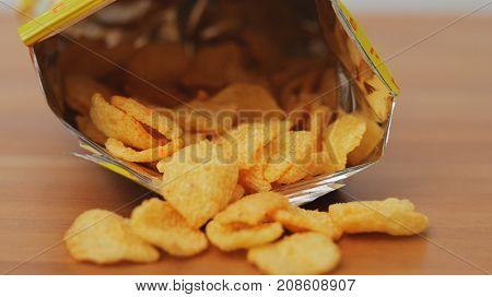Eating Cheese crisp in package