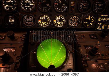 Airplane Green Glowing Radar With Aircraft Gauges, Switches, And Knobs