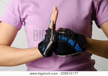 Woman wear bicycle gloves for cycling, protection and safe