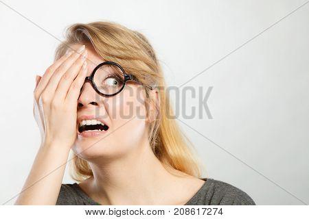 Scared Girl In Glasses.