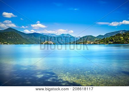 Orta Lake landscape. Orta San Giulio village island Isola S.Giulio and Alps mountains view Piedmont Italy Europe. Long Exposure.