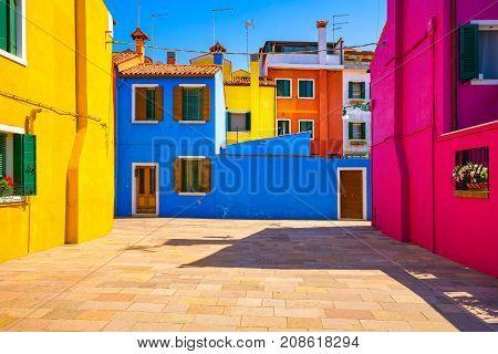 Venice landmark Burano island square and colorful houses Italy Europe.
