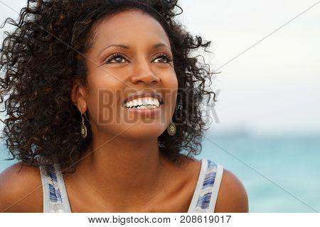 Beautiful mature woman smiling at the beach.