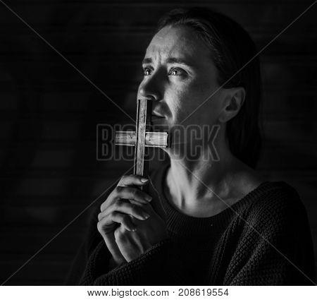 Woman Holding Cross Praying for God