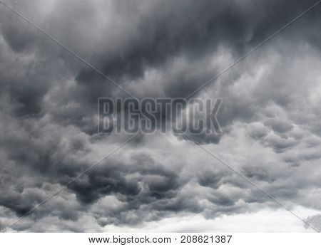 dramatic dark sky with storm cloud before thunder storm