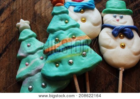 Candy christmas tree shape and snow man. Top view .